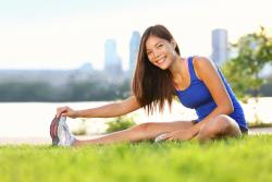 Female in Plano, TX stretching while wearing multifocal contact lenses